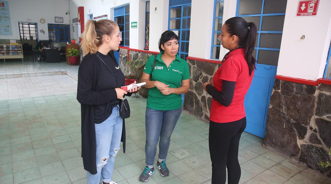 Refugee support volunteers discussing the asylum process in Mexico.